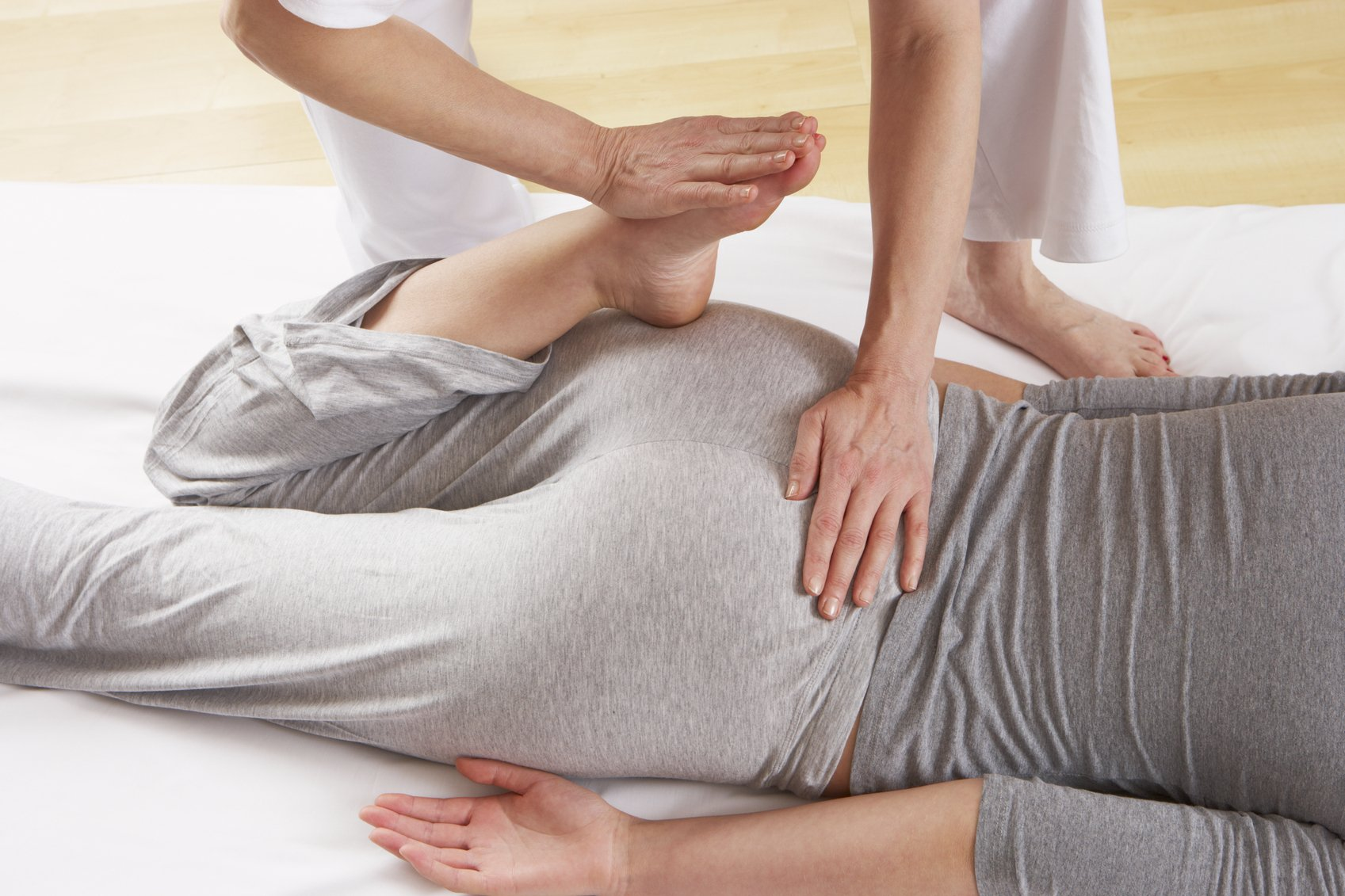 Woman having Shiatsu massage indoors