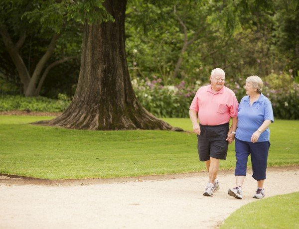 a couple walks through the park for fresh air and exercise