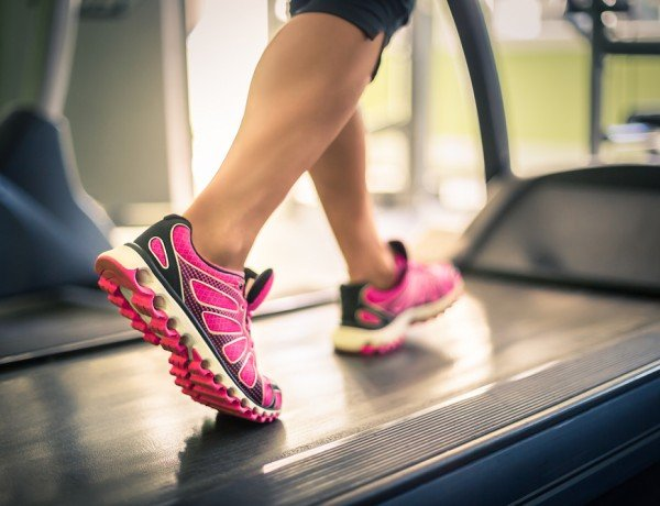 a cancer survivor walking on a treadmill for low impact exercise