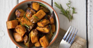 bowl of oven roasted sweet potato with rosemary and thyme