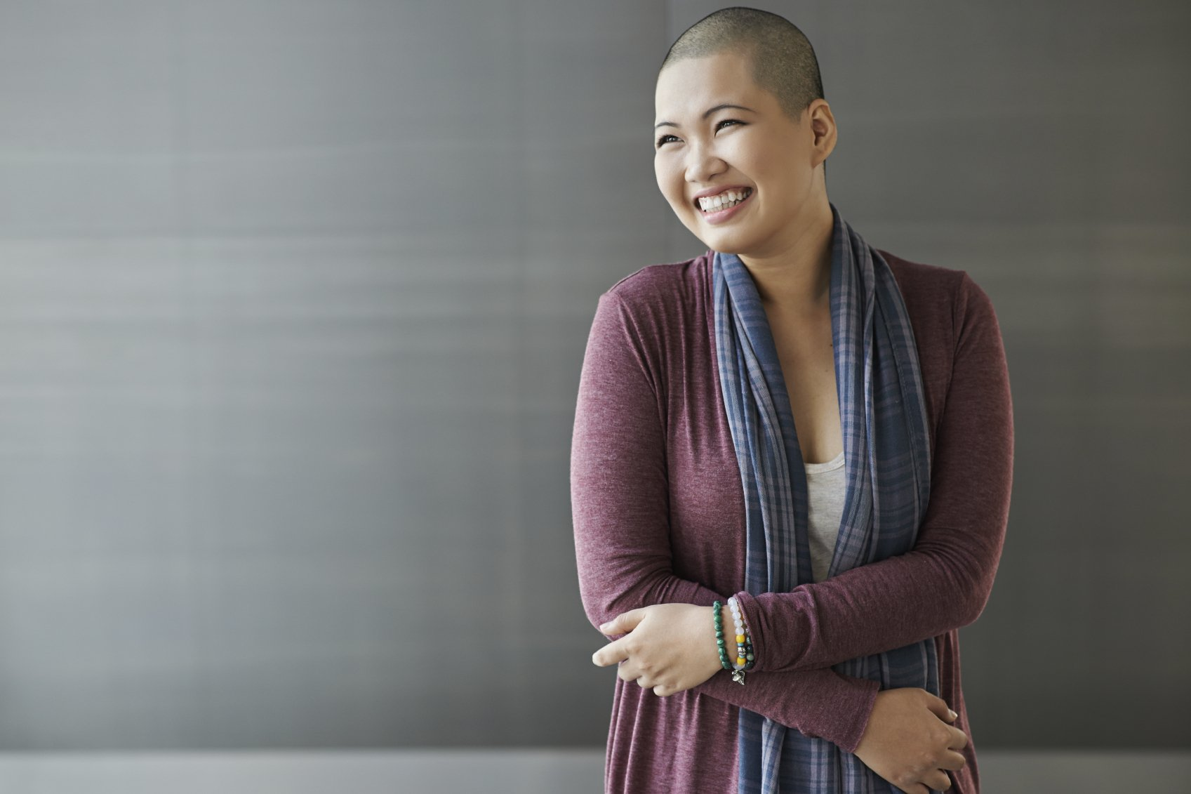 stock photo portrait of a happy breast cancer survivor