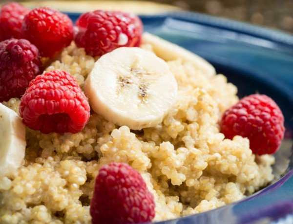 Quinoa breakfast bowl with fresh raspberries and bananas
