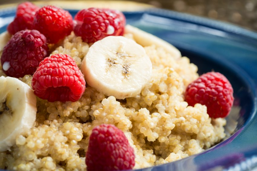 Quinoa breakfast bowl with fresh raspberries and bananas