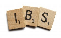 "Wooden scrabble tiles spelling ""IBS"" - for editorial use only"