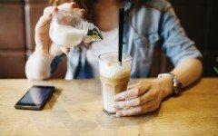 pouring sugar into a latte
