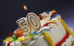 birthday cake with candles shaped like the number 50