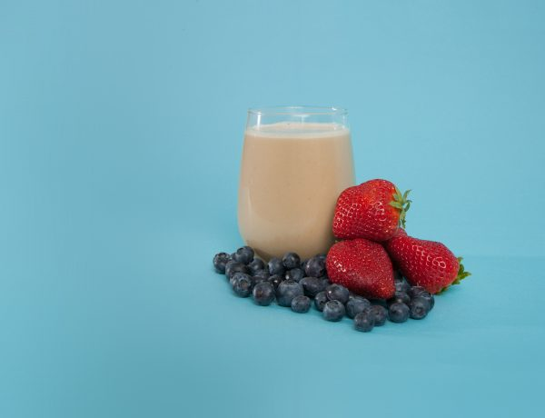 a glass of soylent and berries