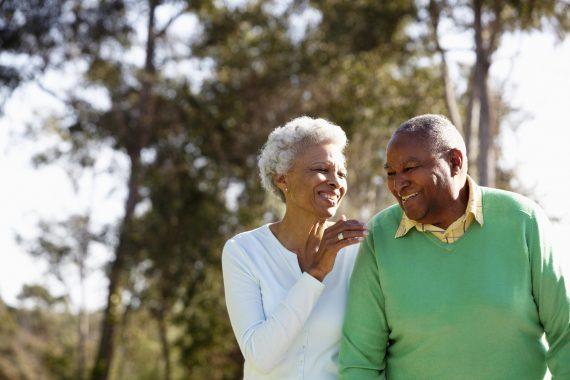 Senior Couple Enjoying Walk Together In The Park